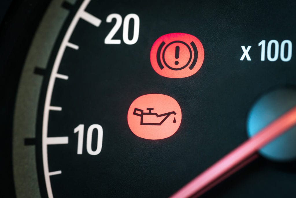Car dashboard with oil warning light on