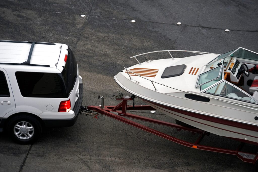 Texas Trailer Registration - Car towing boat with trailer